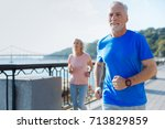 fit senior man jogging together ... | Shutterstock . vector #713829859