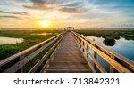 boardwalk into the rising sun... | Shutterstock . vector #713842321