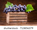 fresh grape with leaves in a... | Shutterstock . vector #713856379