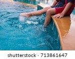 little kid in pool   Shutterstock . vector #713861647