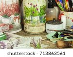 Small photo of BRNO, CZECH REPUBLIC -10 September, 2017: Products made by decoupage technique. Decoupage is a technique of decorating items napkins. Workshop of the painter. Work desk mess