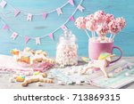 pink cake pops in a teacup | Shutterstock . vector #713869315