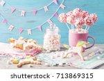 pink cake pops in a teacup | Shutterstock . vector #713869315