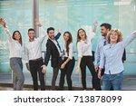 group of happy coworkers... | Shutterstock . vector #713878099
