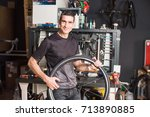 male smiling master holding a... | Shutterstock . vector #713890885