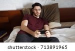 young handsome man watching... | Shutterstock . vector #713891965
