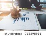 business man hand holding pen... | Shutterstock . vector #713895991