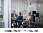 business people sitting in... | Shutterstock . vector #713909305