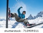 cheerful man playing with snow... | Shutterstock . vector #713909311