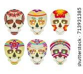 set of sugar skulls with... | Shutterstock .eps vector #713931385