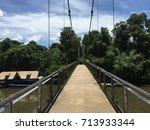 suspension bridge in... | Shutterstock . vector #713933344