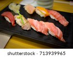 close up of sushi rolls on... | Shutterstock . vector #713939965