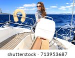 attractive woman enjoys sailing ... | Shutterstock . vector #713953687