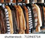luxury fur coats hanging on...   Shutterstock . vector #713965714