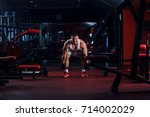 young man exercising with... | Shutterstock . vector #714002029
