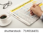 newspaper over table with coffee | Shutterstock . vector #714016651