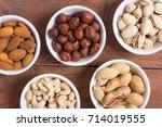 mix of nuts   pistachios ...   Shutterstock . vector #714019555