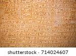 egyptian hieroglyphs on the wall | Shutterstock . vector #714024607