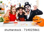 a happy family in costumes... | Shutterstock . vector #714025861