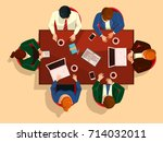 manager team meeting at table... | Shutterstock .eps vector #714032011