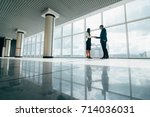 businessman and businesswoman... | Shutterstock . vector #714036031
