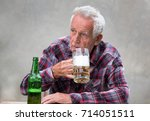 senior man sitting at table and ... | Shutterstock . vector #714051511