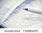 financial accounting. pen and... | Shutterstock . vector #714082639