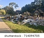 flooding clean up after... | Shutterstock . vector #714094705