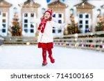 kids ice skating in winter park ...   Shutterstock . vector #714100165