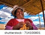 peruvian woman with big hat ... | Shutterstock . vector #714100801