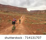 A Group Of Cyclists Travels Th...