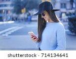 charming brunette female... | Shutterstock . vector #714134641