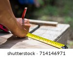 carpenter hand measuring tape...   Shutterstock . vector #714146971