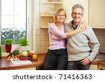 happy elderly couple standing... | Shutterstock . vector #71416363