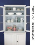 Stock photo cabinet with kitchen objects 71416867