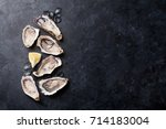 opened oysters  ice and lemon... | Shutterstock . vector #714183004