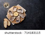 opened oysters  ice and lemon...   Shutterstock . vector #714183115