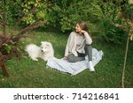 young woman resting with a dog... | Shutterstock . vector #714216841