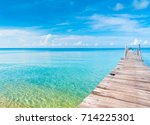 contemplating the sea calm... | Shutterstock . vector #714225301