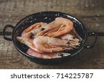 shrimp cooked on a black small... | Shutterstock . vector #714225787