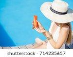 young beautiful woman applying... | Shutterstock . vector #714235657