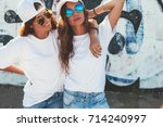 two models wearing plain white... | Shutterstock . vector #714240997