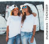 two models wearing plain white... | Shutterstock . vector #714241009