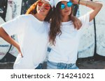 two models wearing plain white... | Shutterstock . vector #714241021