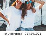 two models wearing plain white... | Shutterstock . vector #714241021