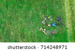 family cycling on bikes... | Shutterstock . vector #714248971