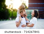 cute young family on a summer... | Shutterstock . vector #714267841