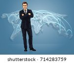 businessman in front of a world ... | Shutterstock .eps vector #714283759