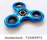 blue spinning fidget spinner on ...   Shutterstock . vector #714305971