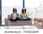 multiethnic couple using... | Shutterstock . vector #714322645